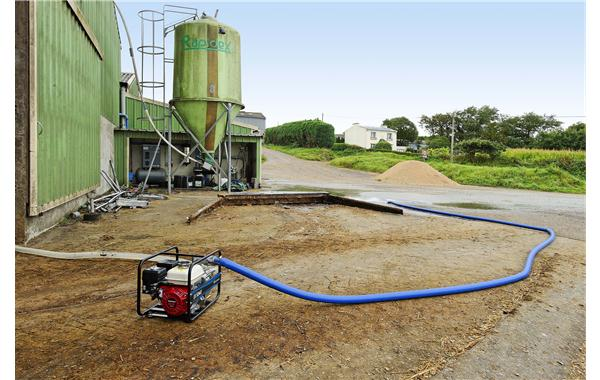 Transferring contaminated water for agriculture using an SDMO water pump